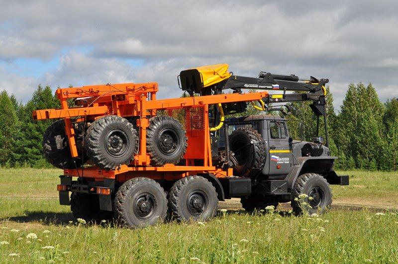 Лесовозный тягач Урал 55571-1112-60Е5 с ГМ ОМТЛ-97