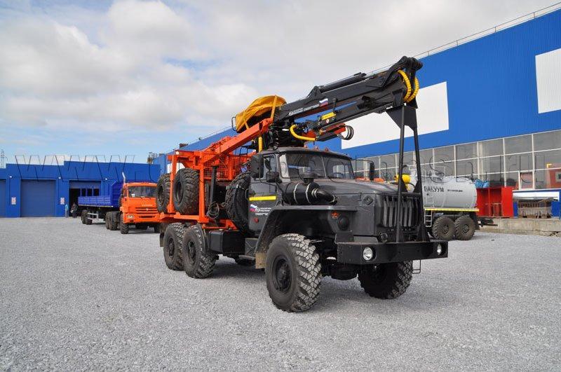 Лесовозный тягач Урал 55571-1112-60 (70) с ГМ ОМТЛ-97